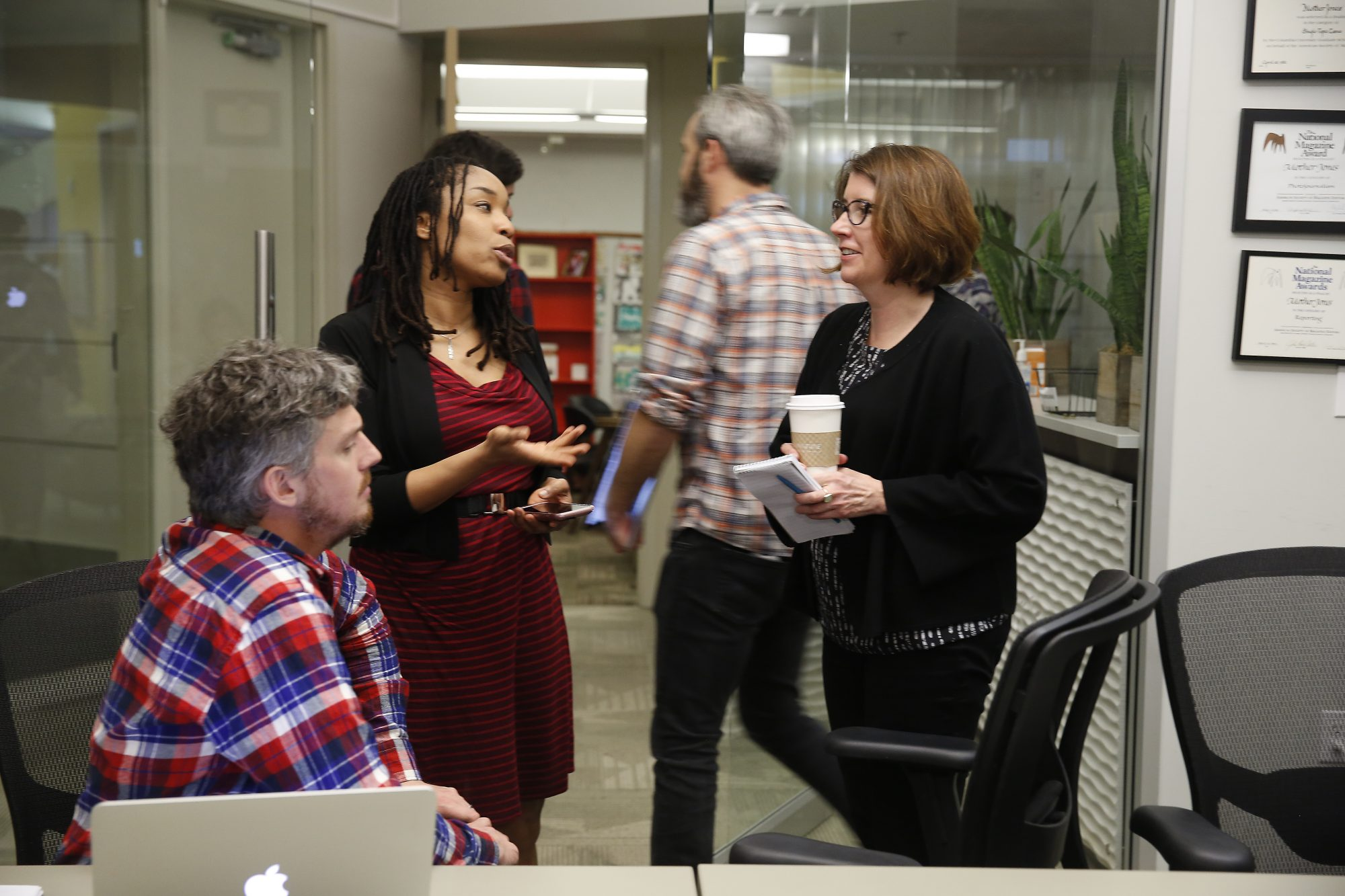Mother Jones' editor in chief Clara Jeffery (right) talks with Jahna Berry (center), director of news product and Clint Hendler (left), news director after a news meeting on Thursday, March 2, 2017 in San Francisco, Calif.
